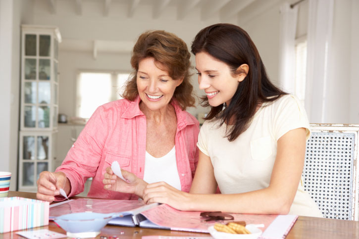 Image of two women organizing scrap book