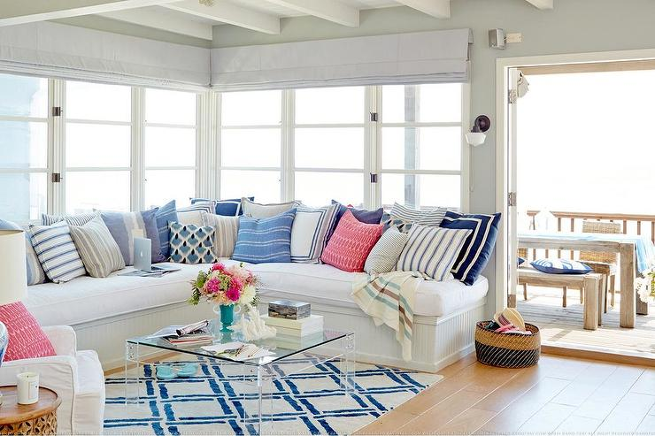 Image of white sofa with numerous throw pillows in a family room