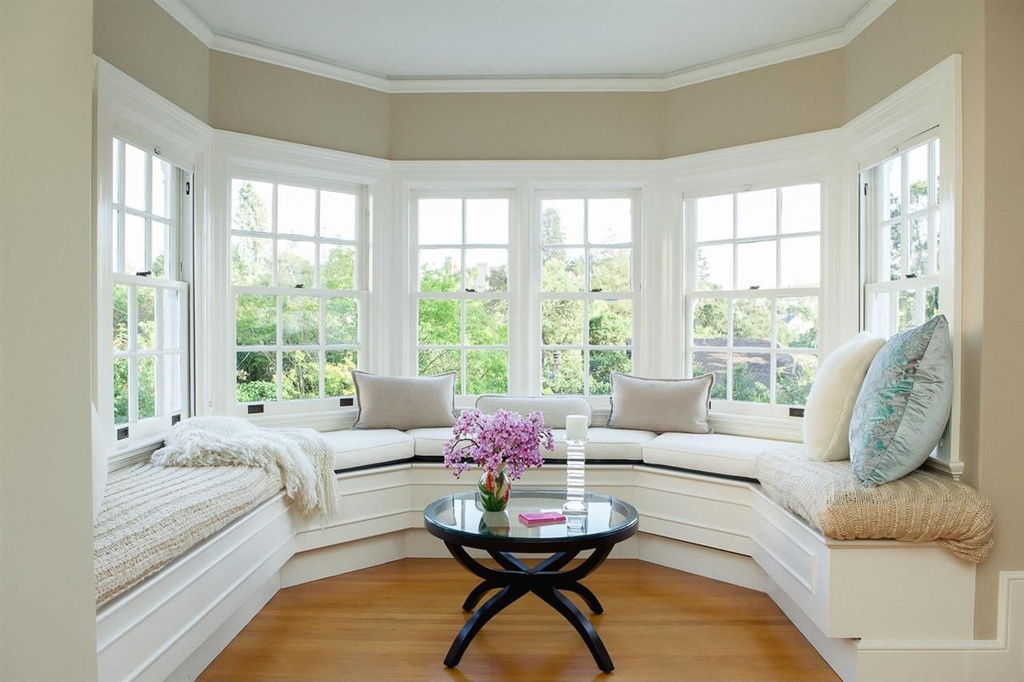 Image of sunroom nook with white benches and beige walls
